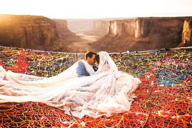 国外情侣追求刺激,一百多米高空上办婚礼! 网络热点 第1张